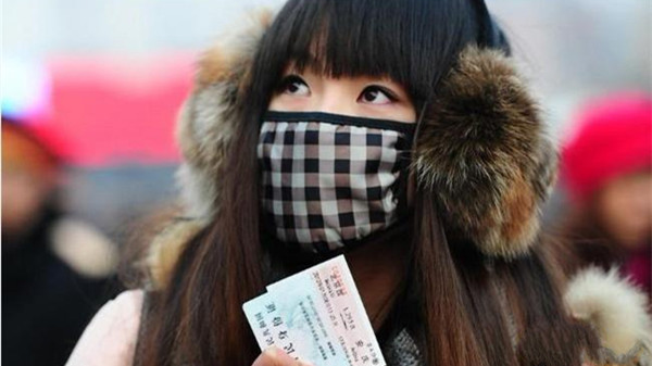 春运遭遇流感高发期 感冒旅客请戴口罩