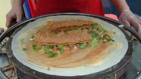 新华社曝黑幕:煎饼中的脆饼来历可疑