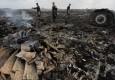马航一客机在乌东部坠毁 机上298人全部遇难