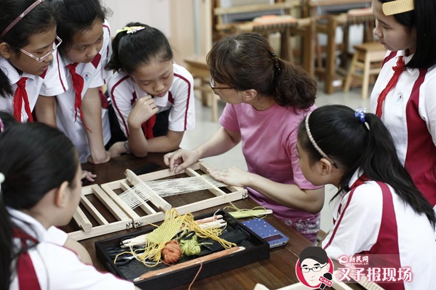 """传统文化""""走""""下书本 孩子动手学纺织练刺绣"""