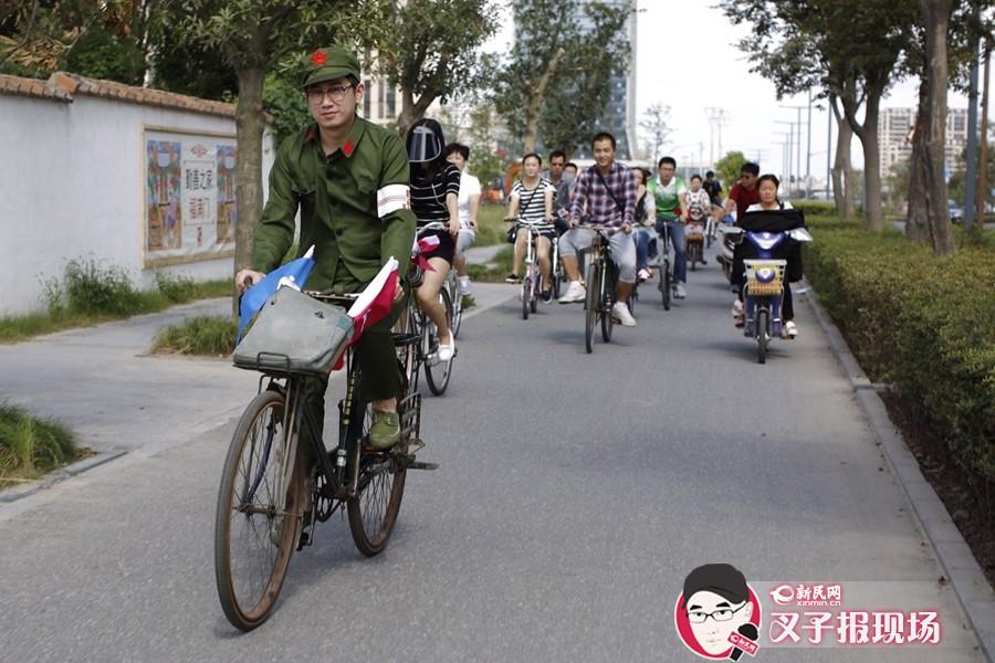 """9月21日,嘉定举办""""我们的街道,我们的选择""""——2014世界无车日怀旧慢骑行活动。新民网 萧君玮 摄"""