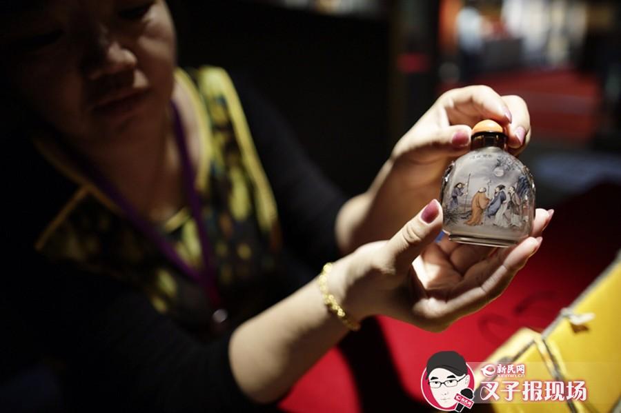 """本次""""京韵绝技非遗文化展""""参展项目包括7个国家级和1个北京市级非物质文化遗产项目,共计近百件(套)作品齐整亮相。新民网 萧君玮 摄"""