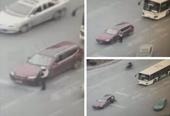 沪交警被拖行致死案开庭 被告当庭否认故意伤害