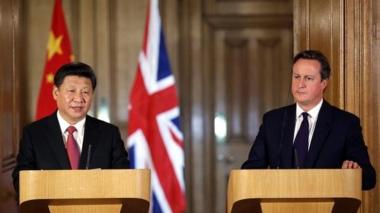 习近平:中国走和平发展道路决心和意志不动摇