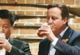 习近平与卡梅伦赴酒吧喝啤酒吃炸鱼薯条
