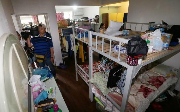 上海白领公寓摇身成群租聚集地