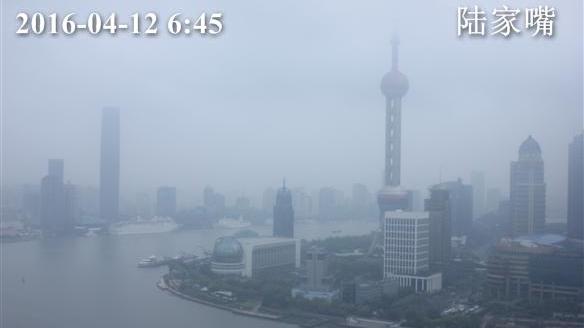 今晨上海上班时段有阵雨 下午雨止转阴