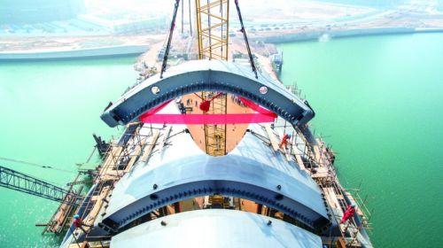 成为国内首座三维曲面珊瑚拱形钢结构桥梁,未来将成为青岛西海岸新区