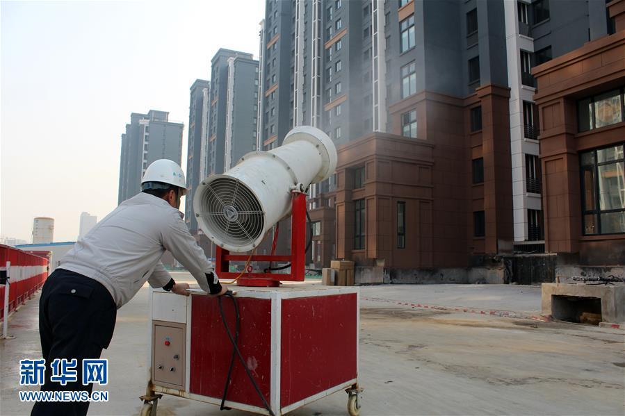 北京建筑工地采取多举措应对雾霾(组图)