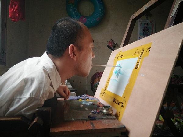 口足绘画画家谢子铭:用嘴用爱画出一片山河