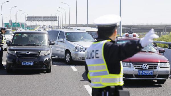 上海:13种严重交通违法将被公开公示 并挂钩个人信用