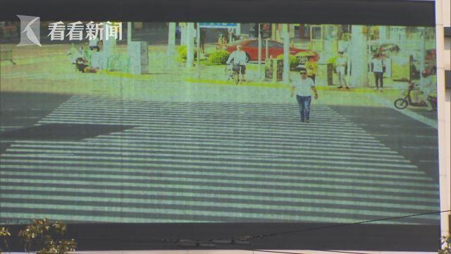 """沪中心城区试点""""行人闯灯""""电子警察  闯灯照户外大屏循环播放"""