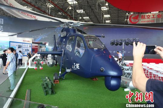 中国<a href='http://search.xinmin.cn/?q=武装直升机' target='_blank' class='keywordsSearch'>武装直升机</a>直19E完成首笔签约